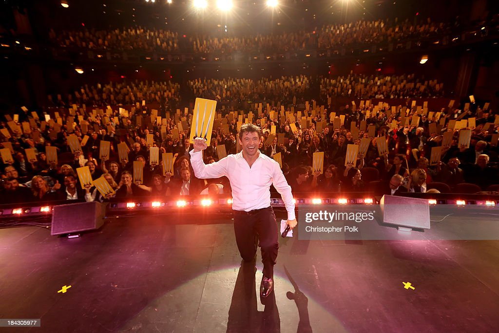 Actor Hugh Jackman performs onstage during 'Hugh Jackman... One Night Only' Benefiting MPTF at Dolby Theatre on October 12, 2013 in Hollywood, California.