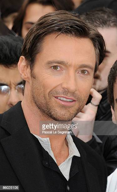 Actor Hugh Jackman poses with fans during a photocall for the 'Wolverine' film on April 17 2009 in Paris France