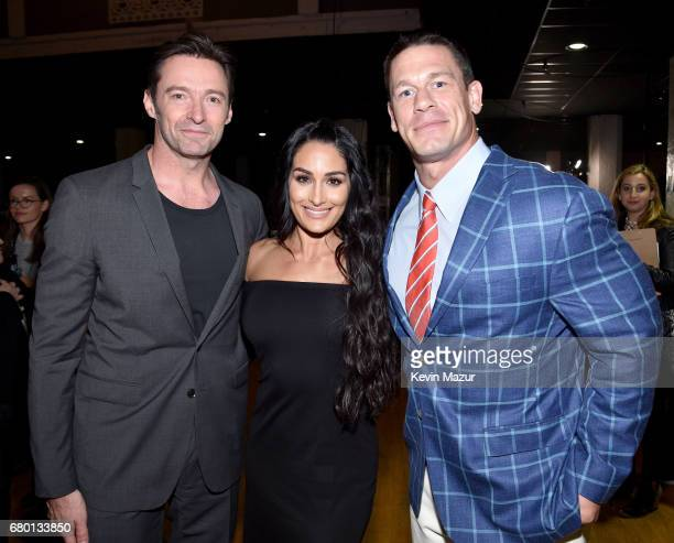 Actor Hugh Jackman professional wrestleractor Nikki Bella and professional wrestleractor John Cena attend the 2017 MTV Movie And TV Awards at The...