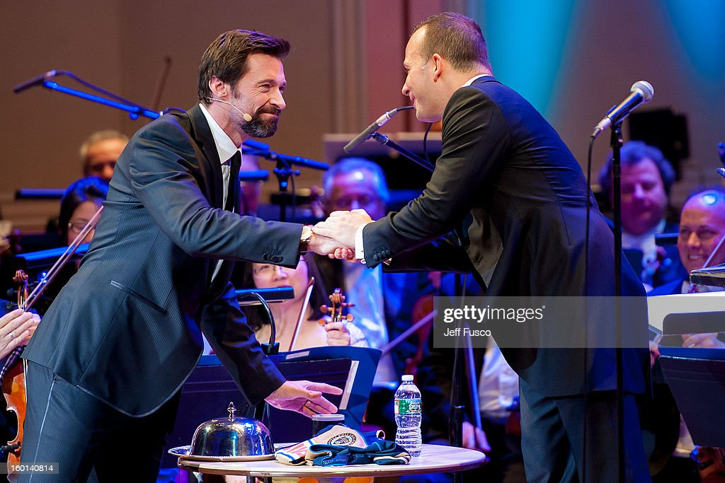 Actor Hugh Jackman (L) shakes hands with Philadelphia Orchestra Music Director Yannick Nézet-Séguin at the Academy of Music's 156th Anniversary Concert at the Academy of Music on January 26, 2013 in Philadelphia, Pennsylvania.