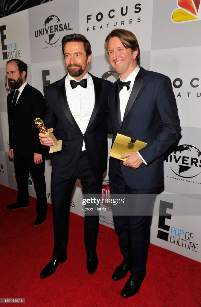 Actor Hugh Jackman (L), winner of Best Actor in a Motion Picture (Musical or Comedy) for 'Les Miserables,' and director Tom Holland attend the NBCUniversal Golden Globes viewing and after party held at The Beverly Hilton Hotel on January 13, 2013 in Beverly Hills, California.