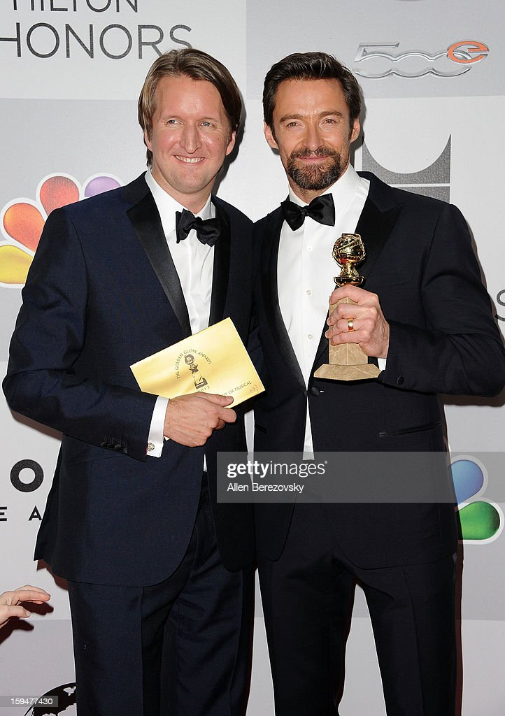 Actor Hugh Jackman (R), winner of Best Actor in a Motion Picture (Musical or Comedy) for 'Les Miserables,' and director Tom Holland arrive at the NBC Universal's 70th annual Golden Globe Awards after party on January 13, 2013 in Beverly Hills, California.