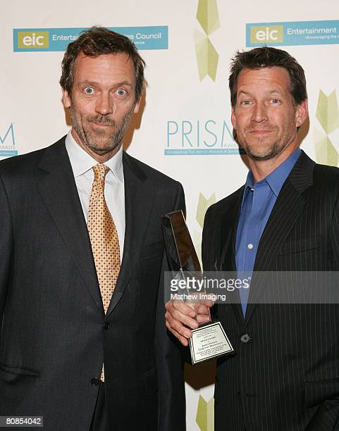 Actor Hugh Laurie and actor James Denton who wins an award for Performance in A Comedy Series 'Desperate Housewives' at The 12th Annual PRISM Awards...