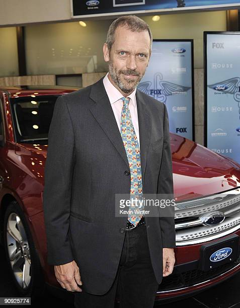 Actor Hugh Laurie arrives at Fox TV's season 6 premiere of 'House' at the Cinerama Dome on September 17 2009 in Los Angeles California