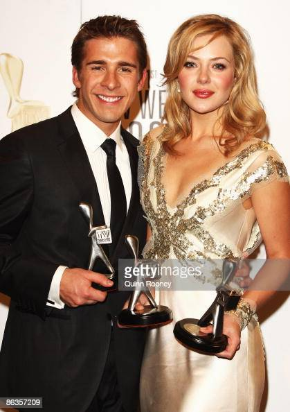 Actor Hugh Sheridan poses with the award for Most Popular New Male Talent and Jessica Marais with the Most Popular New Female Talent Award during the...