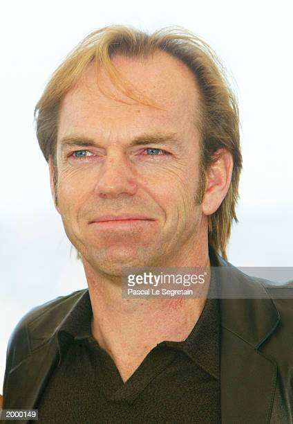 Actor Hugo Weaving poses for the cameras during a photocall for the film 'Matrix Reloaded' at the Palais des Festivals during the 56th International...