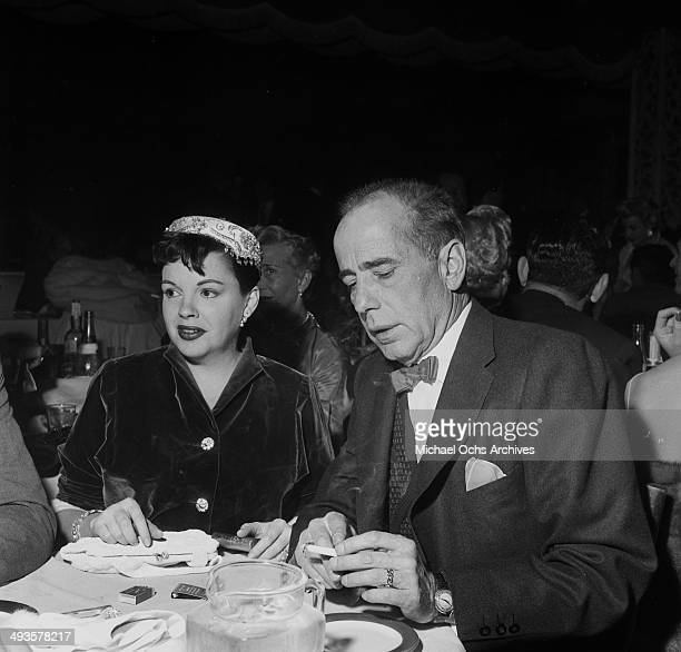 Actor Humphrey Bogart and actress Judy Garland have dinner at Ciro's for Sammy Davis Jr opening in Los Angeles California