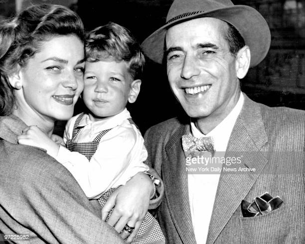 Actor Humphrey Bogart and his wife actress Lauren Bacall with their 2 1/2yearold son Stephen They are shown here as they arrived in New York aboard...