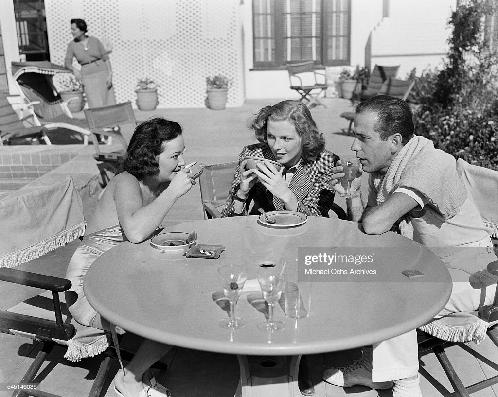 Actor Humphrey Bogart has coffee and drinks with friends in Los Angeles, California.