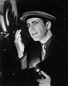 Actor Humphrey Bogart poses for a publicity still for the Warner Bros film 'The Amazing Dr Clitterhouset' in 1938 in Los Angeles California