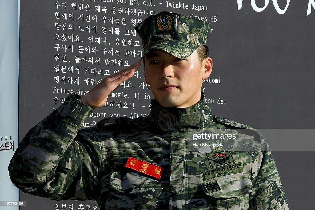 Actor Hyun Bin poses for photographs after being discharged from military service on December 6, 2012 in Gyeonggi-do, South Korea.