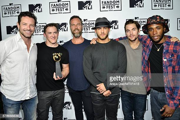 Actor Ian Bohen executive producer Jeff Davis actors JR Bourne Cody Christian Dylan Sprayberry and Khylin Rhambo pose backstage with the Fandom of...