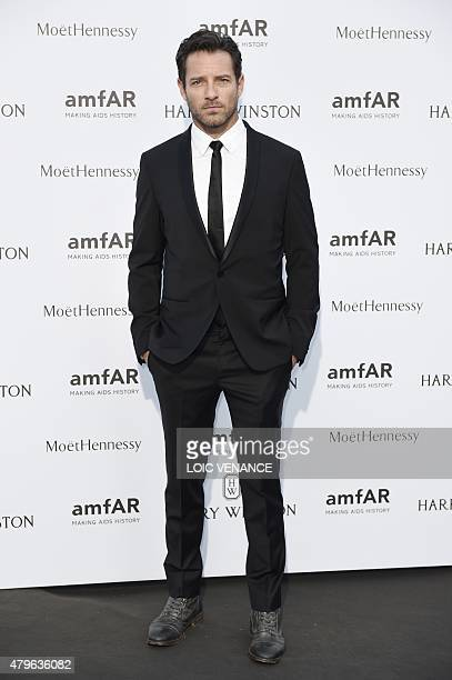 US actor Ian Bohen poses as he arrives for the amfAR dinner on the sidelines of the Paris fashion week in Paris on July 5 2015 AFP PHOTO / LOIC...