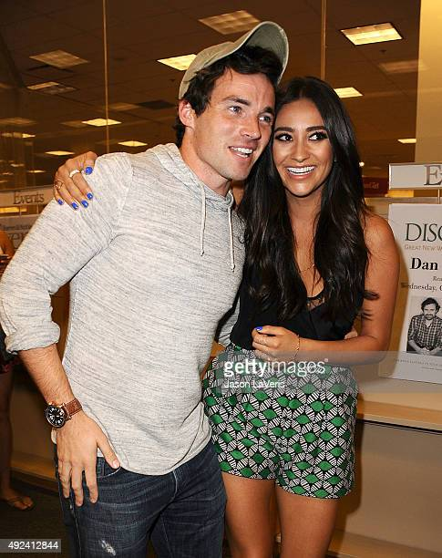 Actor Ian Harding and actress Shay Mitchell attend the book signing for 'Bliss' at Barnes Noble at The Grove on October 12 2015 in Los Angeles...