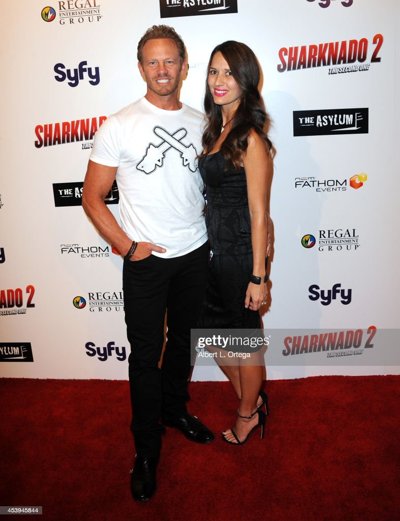 Actor <a gi-track='captionPersonalityLinkClicked' href=/galleries/search?phrase=Ian+Ziering&family=editorial&specificpeople=622264 ng-click='$event.stopPropagation()'>Ian Ziering</a> and wife Erin Kristine Ludwig arrive for the Premiere Of The Asylum & Fathom Events' 'Sharknado 2: The Second One' held at Regal Cinemas L.A. Live on August 21, 2014 in Los Angeles, California.
