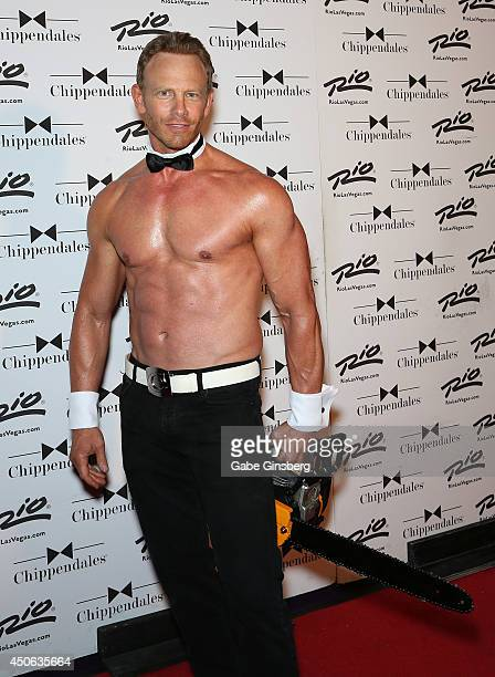 Actor Ian Ziering poses with a chainsaw as he arrives for his return to the Chippendales stage at the Rio Hotel Casino on June 14 2014 in Las Vegas...