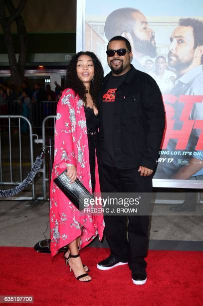 Actor Ice Cube and Kimberly Woodruff pose on arrival for the world premiere of the film 'Fist Fight' in Los Angeles California on February 13 2017 /...