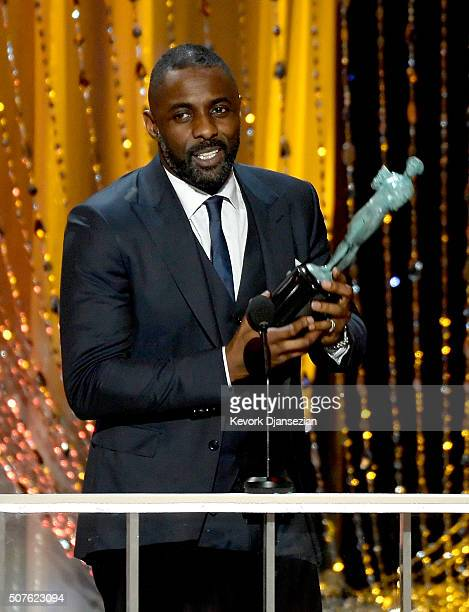 Actor Idris Elba accepts the Outstanding Performance by a Male Actor in a Supporting Role award for 'Beasts of No Nation' onstage during the 22nd...