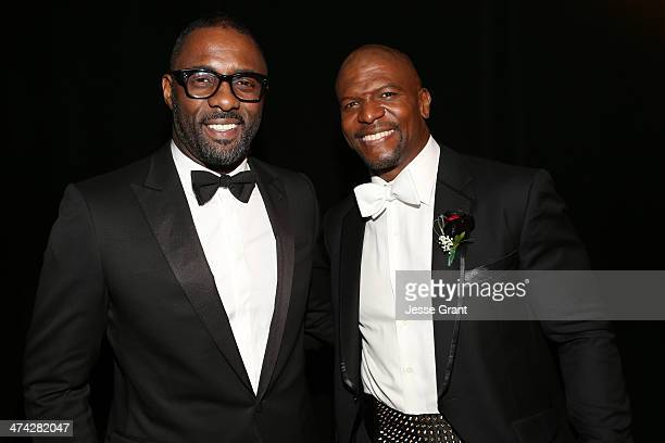 Actor Idris Elba and Actor Terry Crews attend the 45th NAACP Image Awards presented by TV One at Pasadena Civic Auditorium on February 22 2014 in...