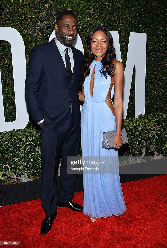Actor <a gi-track='captionPersonalityLinkClicked' href=/galleries/search?phrase=Idris+Elba&family=editorial&specificpeople=215443 ng-click='$event.stopPropagation()'>Idris Elba</a> (L) and actress <a gi-track='captionPersonalityLinkClicked' href=/galleries/search?phrase=Naomie+Harris&family=editorial&specificpeople=238918 ng-click='$event.stopPropagation()'>Naomie Harris</a> arrive at the Los Angeles premiere of 'Mandela: Long Walk To Freedom' at ArcLight Cinemas Cinerama Dome on November 11, 2013 in Hollywood, California.