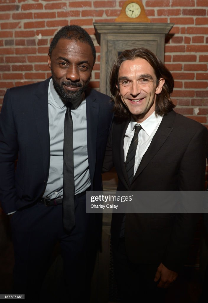 Actor <a gi-track='captionPersonalityLinkClicked' href=/galleries/search?phrase=Idris+Elba&family=editorial&specificpeople=215443 ng-click='$event.stopPropagation()'>Idris Elba</a> (L) and director <a gi-track='captionPersonalityLinkClicked' href=/galleries/search?phrase=Justin+Chadwick&family=editorial&specificpeople=4584510 ng-click='$event.stopPropagation()'>Justin Chadwick</a> attend the after party for 'The Weinstein Company Presents The LA Premiere Of 'Mandela: Long Walk To Freedom' Supported By Burberry' at Warwick on November 11, 2013 in Los Angeles, California.