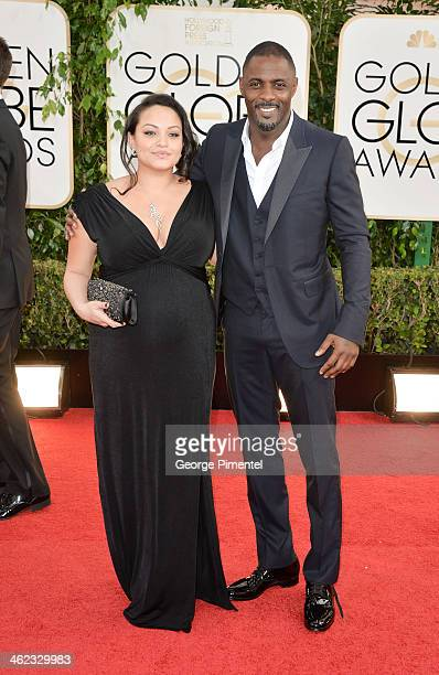 Actor Idris Elba and Naiyana Garth arrive at the 71st Annual Golden Globe Awards at The Beverly Hilton Hotel on January 12 2014 in Beverly Hills...