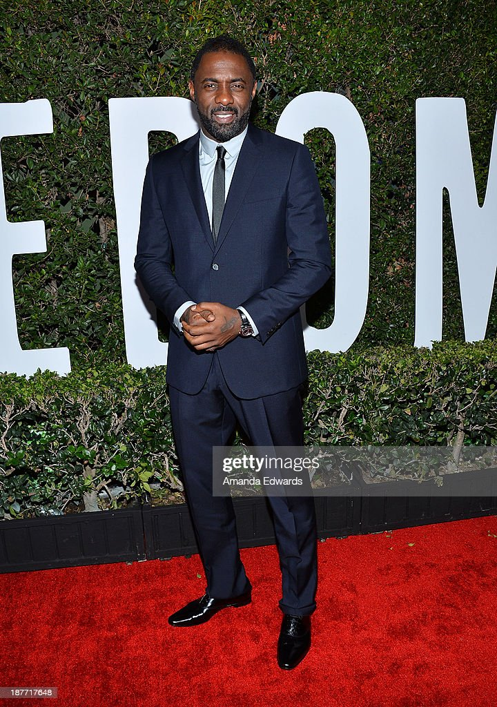 Actor <a gi-track='captionPersonalityLinkClicked' href=/galleries/search?phrase=Idris+Elba&family=editorial&specificpeople=215443 ng-click='$event.stopPropagation()'>Idris Elba</a> arrives at the Los Angeles premiere of 'Mandela: Long Walk To Freedom' at ArcLight Cinemas Cinerama Dome on November 11, 2013 in Hollywood, California.