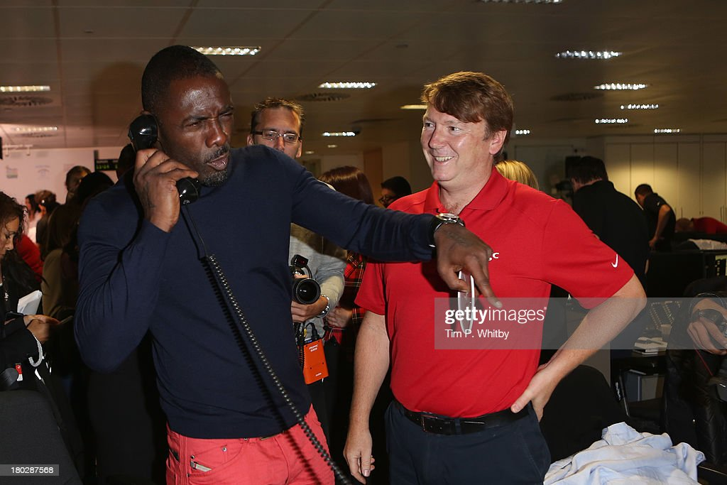 Actor <a gi-track='captionPersonalityLinkClicked' href=/galleries/search?phrase=Idris+Elba&family=editorial&specificpeople=215443 ng-click='$event.stopPropagation()'>Idris Elba</a> speaks on the phone on the trading floor during the BGC Charity Day 2013 at BGC Partners on September 11, 2013 in London, England.