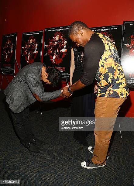 Actor Iko Uwais and professional kickboxer Wayne Barrett attend 'The Raid 2' special screening at Sunshine Landmark on March 17 2014 in New York City