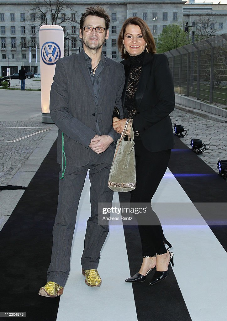 Actor <a gi-track='captionPersonalityLinkClicked' href=/galleries/search?phrase=Ingo+Naujoks&family=editorial&specificpeople=4524004 ng-click='$event.stopPropagation()'>Ingo Naujoks</a> and wife arrive forthe Volkswagen New Beetle world premiere of the 21st Century Beetle at ewerk on April 18, 2011 in Berlin, Germany. The car will be available for sale in Germany in October 2011.