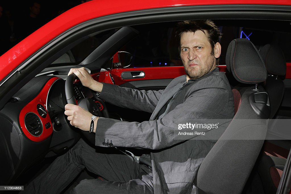 Actor <a gi-track='captionPersonalityLinkClicked' href=/galleries/search?phrase=Ingo+Naujoks&family=editorial&specificpeople=4524004 ng-click='$event.stopPropagation()'>Ingo Naujoks</a> sits in the Volkswagen New Beetle during the world premiere of the 21st Century Beetle at ewerk on April 18, 2011 in Berlin, Germany. The car will be available for sale in Germany in October 2011.