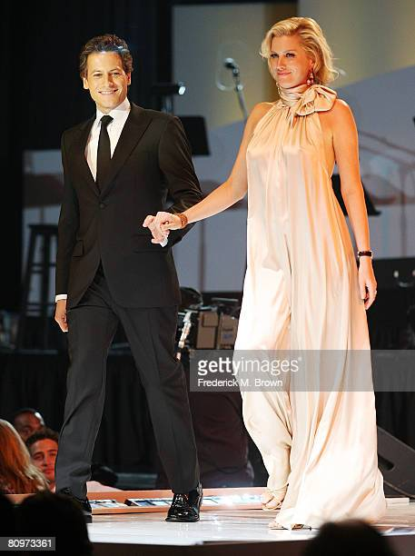 Actor Ioan Gruffudd and actress Alice Evans walk the runway during a fashion show at the 15th Annual Race to Erase MS event at the Hyatt Regency...