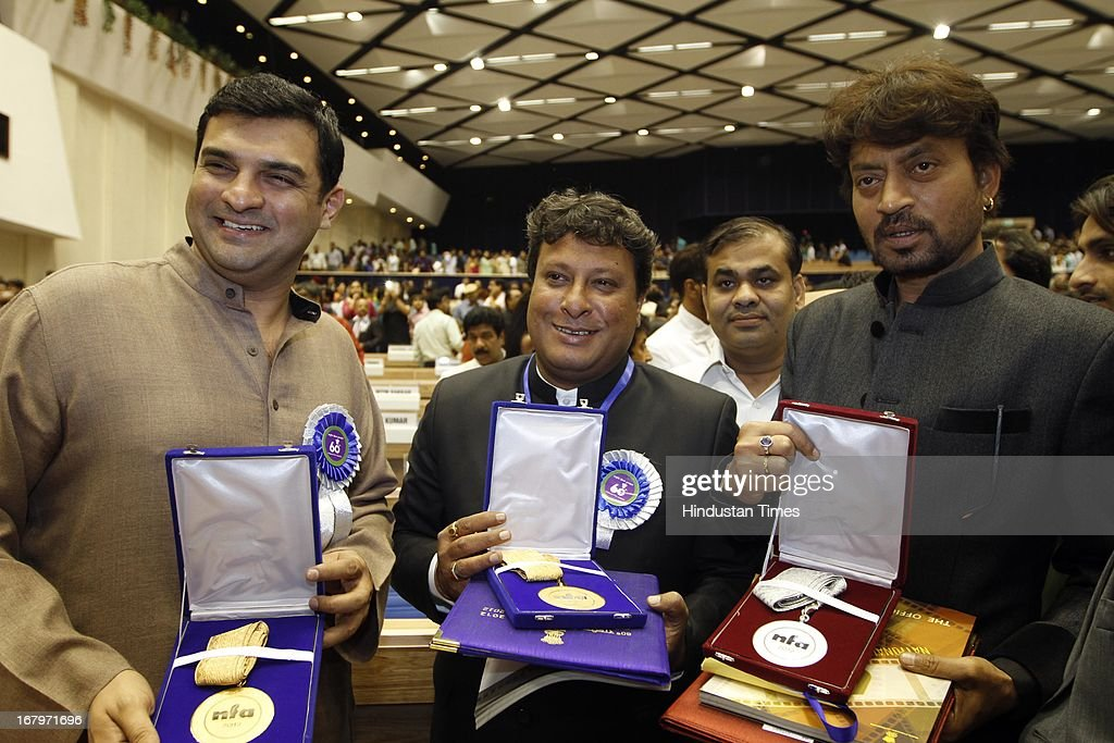 Actor Irfan Khan, Director Tigmanshu Dhulia and <a gi-track='captionPersonalityLinkClicked' href=/galleries/search?phrase=Siddharth+Roy+Kapur&family=editorial&specificpeople=6236847 ng-click='$event.stopPropagation()'>Siddharth Roy Kapur</a> during the presentation of 60th National Film Awards on May 03, 2013 in New Delhi , India. Paan Singh Tomar' got best film award and its lead actor Irrfan Khan adjudged as the best actor.