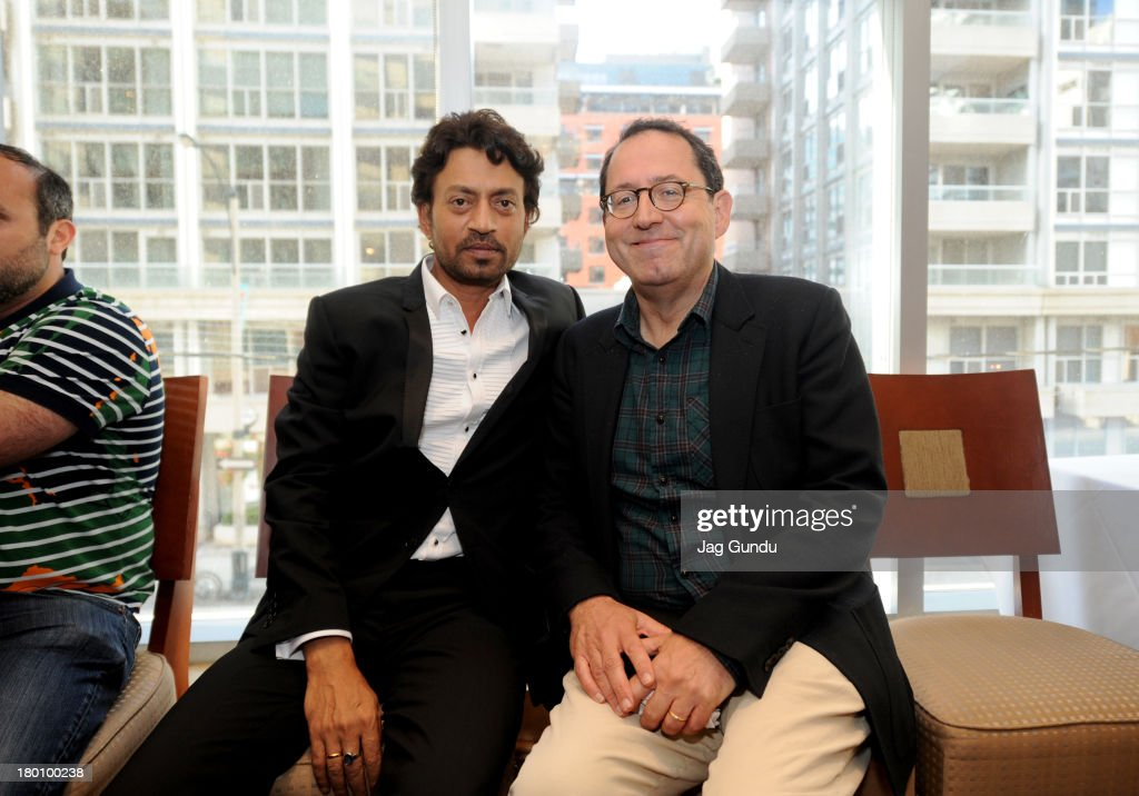 Actor Irrfan Khan and co-President of Sony Pictures Classics Michael Barker attend the 'The Lunchbox' Premiere during the 2013 Toronto International Film Festival at Roy Thomson Hall on September 8, 2013 in Toronto, Canada.