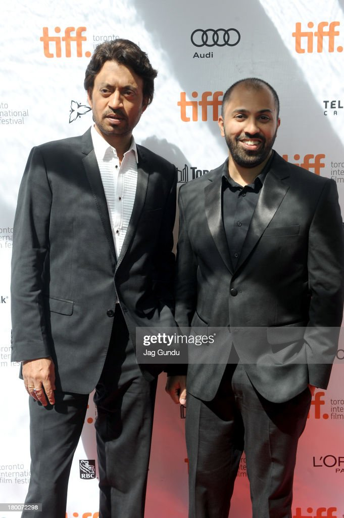 Actor Irrfan Khan and Director Ritesh Batra arrive at the 'The Lunchbox' Premiere during the 2013 Toronto International Film Festival at Roy Thomson Hall on September 8, 2013 in Toronto, Canada.