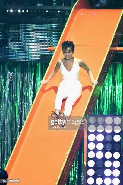 Actor Isabela Moner slides onstage at Nickelodeon's 2017 Kids' Choice Awards at USC Galen Center on March 11 2017 in Los Angeles California