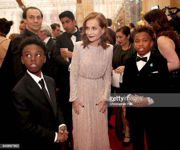 Actor Isabelle Huppert with actors Alex R Hibbert and Jaden Piner attend the 89th Annual Academy Awards at Hollywood Highland Center on February 26...