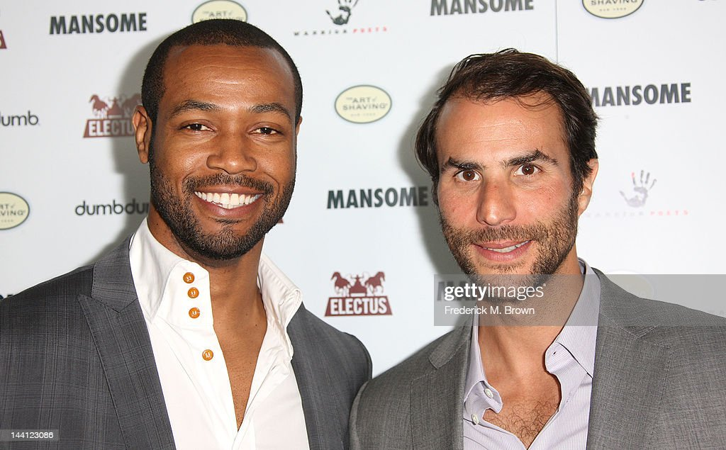 Actor <a gi-track='captionPersonalityLinkClicked' href=/galleries/search?phrase=Isaiah+Mustafa&family=editorial&specificpeople=3527764 ng-click='$event.stopPropagation()'>Isaiah Mustafa</a> (L) and executive producer Ben Silverman attend the premiere of Morgan Spurlock's 'Mansome' at the ArcLight Cinemas on May 9, 2012 in Hollywood, California.