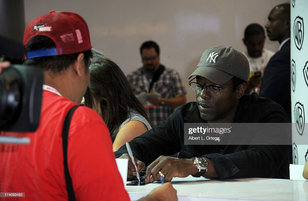 Actor Isaiah Washington signs autographs during Comic-Con International at San Diego Convention Center on July 19, 2013 in San Diego, California.