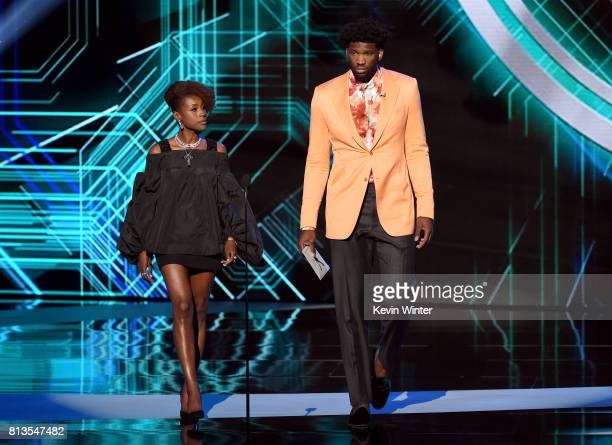 Actor Issa Rae and NBA player Joel Embiid speak onstage at The 2017 ESPYS at Microsoft Theater on July 12 2017 in Los Angeles California