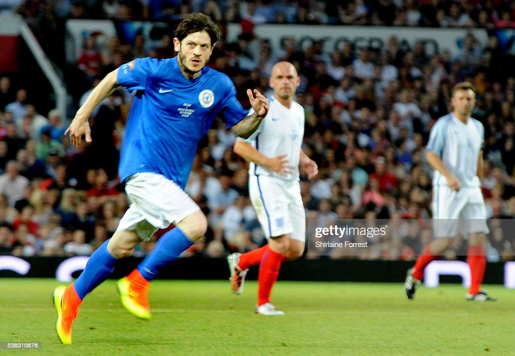 Actor Iwan Rheon plays during Soccer Aid at Old Trafford on June 5, 2016 in Manchester, England.