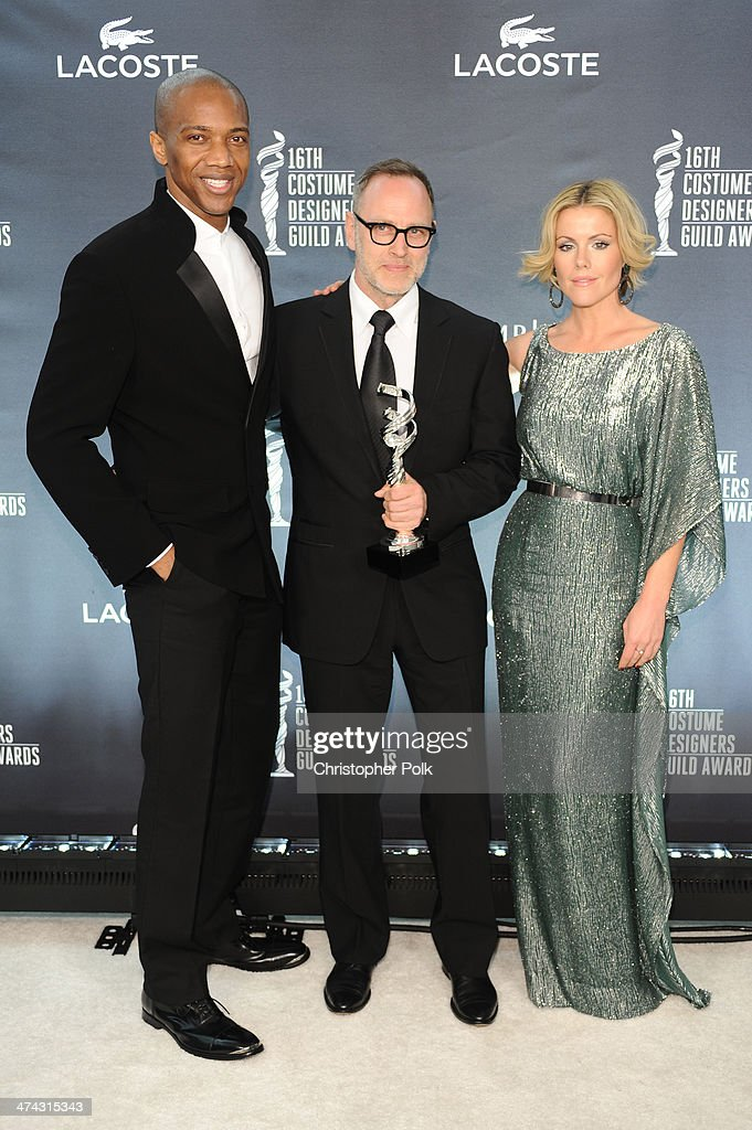 Actor J. August Richards, costume designer Tom Broecker and actress Kathleen Robertson pose with the award for Outstanding Contemporary Television Series for House of Cards during the 16th Costume Designers Guild Awards with presenting sponsor Lacoste at The Beverly Hilton Hotel on February 22, 2014 in Beverly Hills, California.