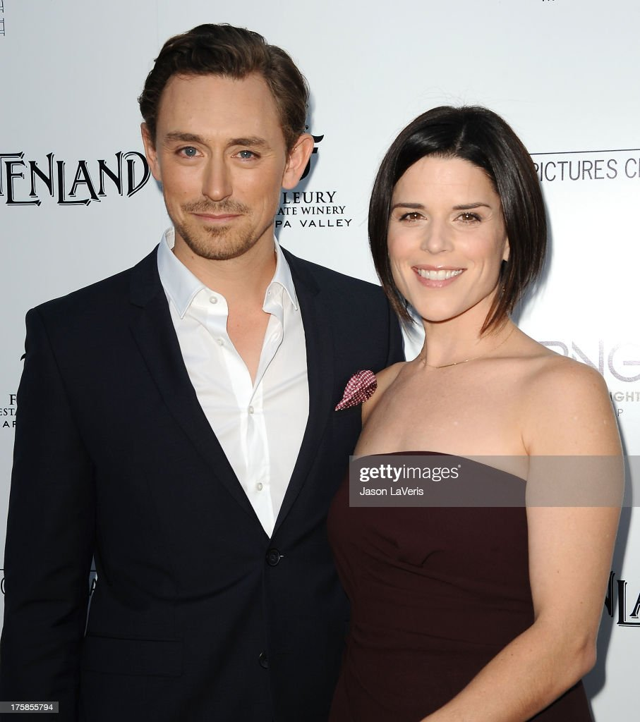 Actor J. J. Feild and actress <a gi-track='captionPersonalityLinkClicked' href=/galleries/search?phrase=Neve+Campbell&family=editorial&specificpeople=202239 ng-click='$event.stopPropagation()'>Neve Campbell</a> attend the premiere of 'Austenland' at ArcLight Hollywood on August 8, 2013 in Hollywood, California.