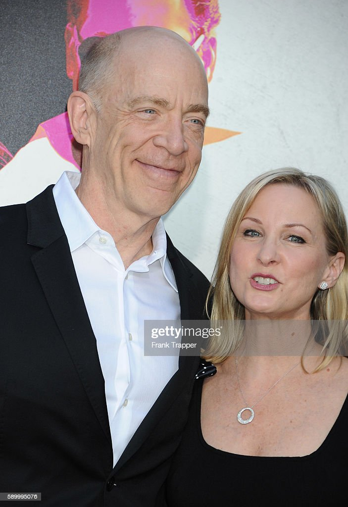Actor J K Simmons and Michelle Schumacher attend the premiere of Warner Bros Pictures' 'War Dogs' held at the TCL Chinese Theater on August 15 2016...