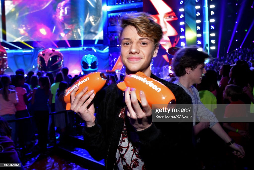Actor Jace Norman poses with awards for Favorite Male TV Star and Favorite TV Show – Kids' Show for 'Henry Danger' backstage at Nickelodeon's 2017 Kids' Choice Awards at USC Galen Center on March 11, 2017 in Los Angeles, California.