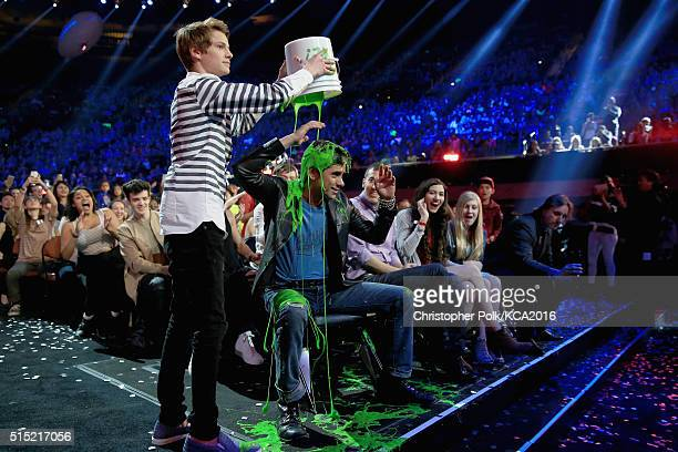 Actor Jace Norman slimes actor John Stamos during Nickelodeon's 2016 Kids' Choice Awards at The Forum on March 12 2016 in Inglewood California