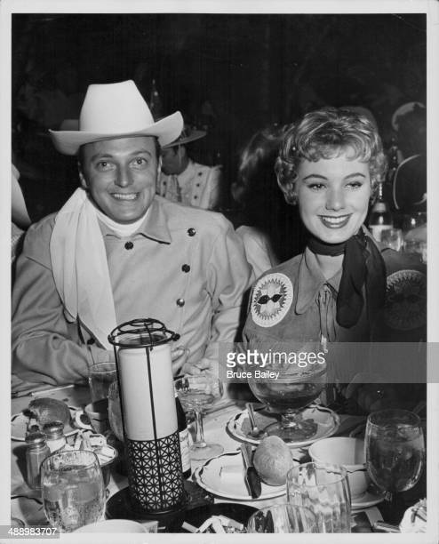 Actor Jack Cassidy and his wife Shirley Jones attending a Share Benefit Party at the Coconut Grove Los Angeles circa 19651974