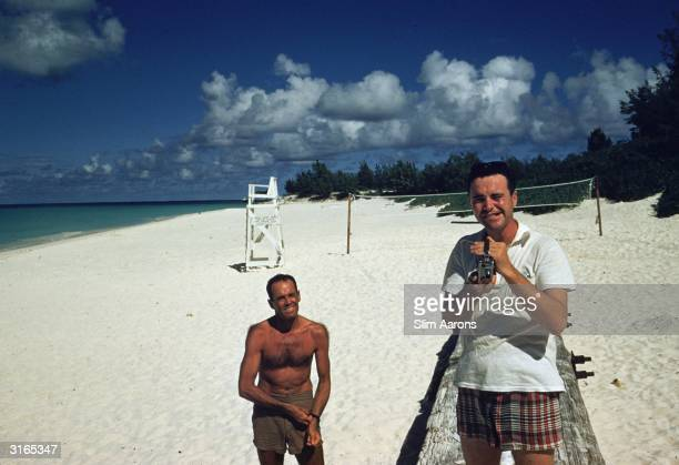 Actor Jack Lemmon filming Slim Aarons taking a picture of him on the beach in Hawaii during the filming of the service comedy 'Mister Roberts' Henry...