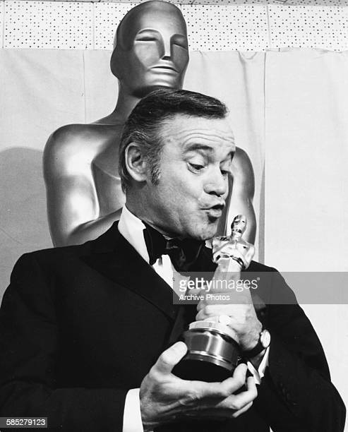 Actor Jack Lemmon kissing his Best Actor Oscar for the film 'Save the Tiger' at the 46th Academy Awards Los Angeles April 2nd 1974