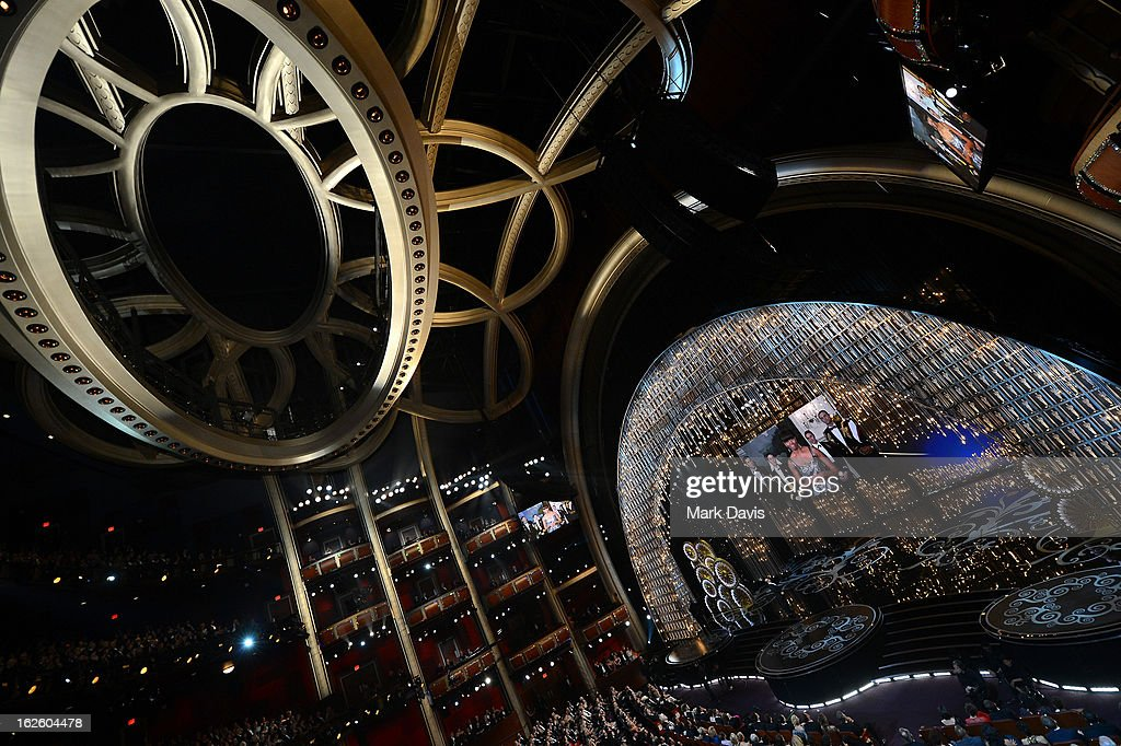 Actor Jack Nicholson along with First lady Michelle Obama seen on the video board present the Best Picture award onstage during the Oscars held at the Dolby Theatre on February 24, 2013 in Hollywood, California.